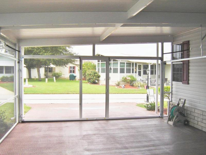 Garage door screens national overhead door for Retractable double garage door screen